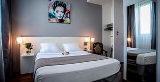 Hotel Le Manoir - לה רושל - חדר שינה