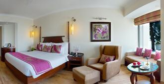 Royal Orchid Fort Resort - מוסורי - חדר שינה