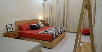 Oke Baik Hostel - Yogyakarta - Bedroom