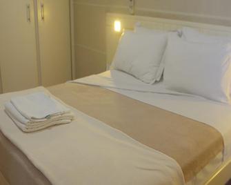 OYO Hotel Universo Palace - Uberlândia - Bedroom