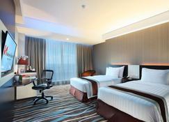 Swiss-Belhotel Makassar - Makassar - Slaapkamer