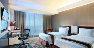 Swiss-Belhotel Makassar - Makassar - Bedroom