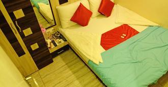 Hotel New India - Mumbai - Phòng ngủ