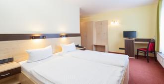 Hotel Mit-mensch - ברלין - חדר שינה