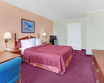 Howard Johnson by Wyndham Tropical Palms Kissimmee - Kissimmee - Quarto