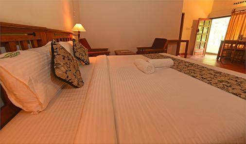 Glenmore Resorts - Munnar - Phòng ngủ