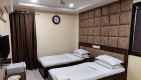 Hotel Metro Palace - Мумбаи - Спальня