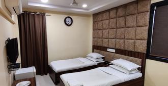 Hotel Metro Palace - מומבאי - חדר שינה