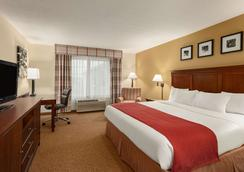 Country Inn & Suites by Radisson, Ames, IA - Ames - Schlafzimmer
