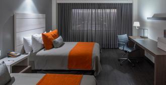 Real Inn Tijuana by Camino Real Hotels - Tijuana - Bedroom