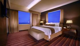 Aston Makassar Hotel & Convention Center - Kota Makassar - Kamar Tidur