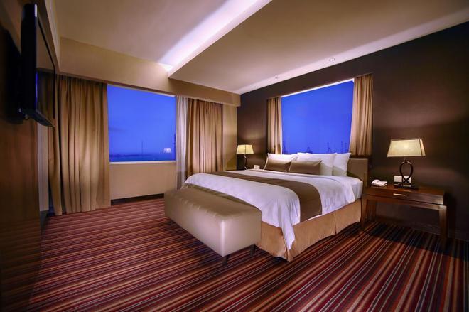 Aston Makassar Hotel & Convention Center - Makassar - Phòng ngủ