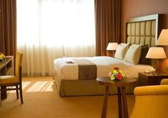 City Seasons Al Hamra Hotel - Abu Dhabi - Phòng ngủ