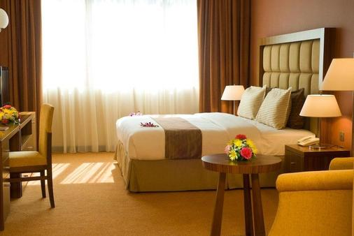 City Seasons Al Hamra Hotel - Abu Dhabi - Bedroom
