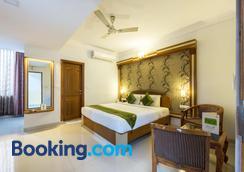 Treebo Trend Akshaya Lalbagh Inn - Bengaluru - Bedroom