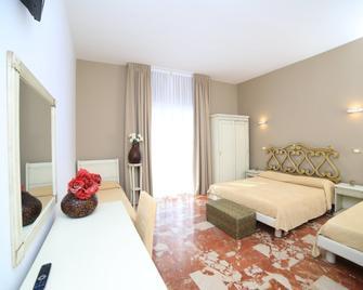 Quilungomare - Porto Cesareo - Habitación