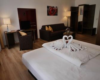 Romantica Hotel Blauer Hecht - Дінкельсбюль - Спальня