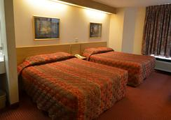 Smoky Mountain Inn & Suites - Cherokee - Bedroom