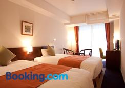 Hotel Yugaf Inn Okinawa - Nago - Bedroom