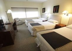 阿爾瑪克魯斯飯店和會議中心 - 聖地亞哥 - 臥室
