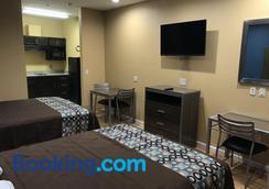 Deluxe Inn & Suites Baytown - Baytown - Bedroom