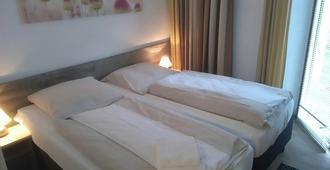 ホテル アム ニコライオート - オスナブリュック - 寝室