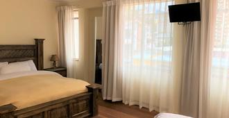 Star Shine B&B - La Paz - Schlafzimmer
