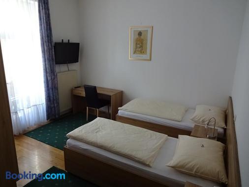 Hotel-Garni & Hostel Sandwirt - Бад-Ишль - Спальня