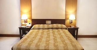 Cherry Blossoms Hotel - Manilla - Slaapkamer