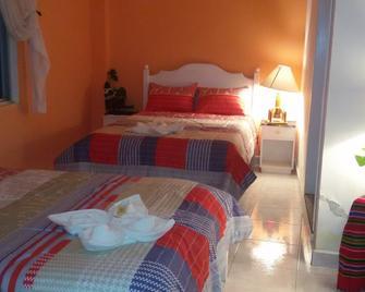 Hotel y Restaurante Eco Chibulbut - Coban - Bedroom