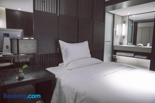 XI'an Eastern House Boutique Hotel - Xi'an - Bedroom