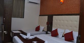 Hotel Sun Star Residency - Mumbai - Phòng ngủ
