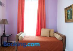 Vogiatzopoulou Guesthouse - Agios Georgios Nileias - Bedroom