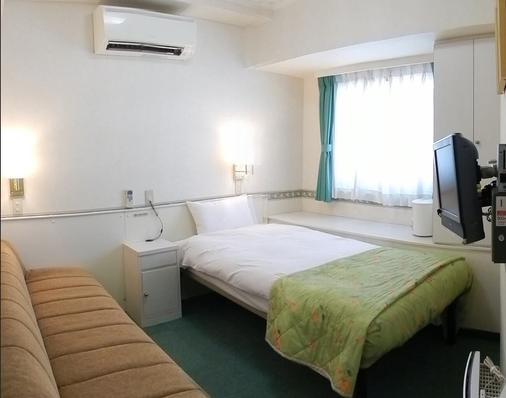 Hotel Sambancho - Matsuyama - Schlafzimmer