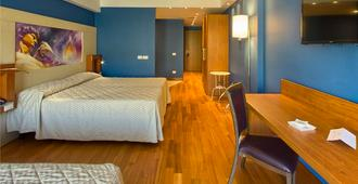 Catania International Airport Hotel - Catania - Schlafzimmer