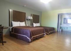 Simple Rewards Inn - Roswell - Bedroom
