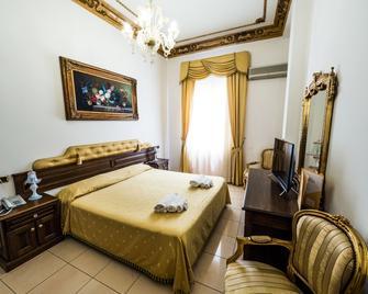 Euro Hotel Iglesias - Bet Schemesch - Schlafzimmer