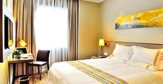 Home Inn Plus - קונמינג - חדר שינה