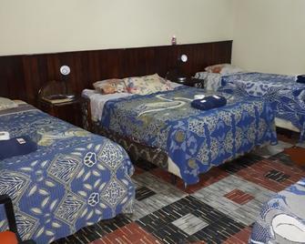 Hotel Casa del Viajero - Hostel - Кесальтенанго - Bedroom