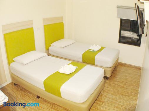薩利姆 DG 經濟型酒店 - 帕謝 - 帕塞 - 臥室