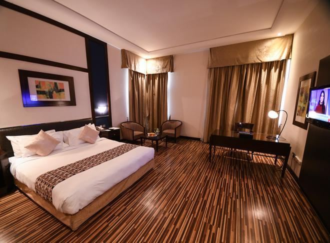 The Juffair Grand Hotel - Manama - Bedroom