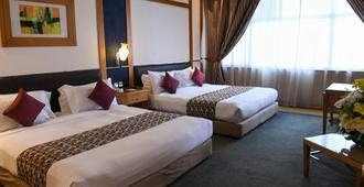 The Juffair Grand Hotel - מאנאמה - חדר שינה