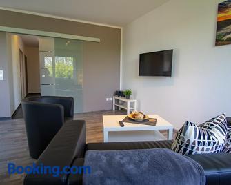 Ferienwohnung Dorfbrunnen - Merzig - Living room