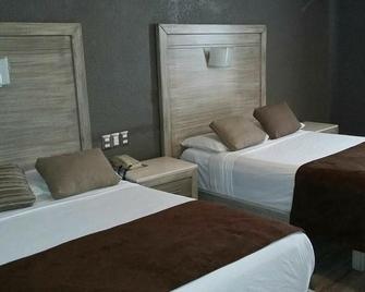 Hotel El Monte - Salamanca - Schlafzimmer