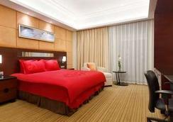 Ramada Plaza by Wyndham Lianyungang - Lianyungang - Schlafzimmer