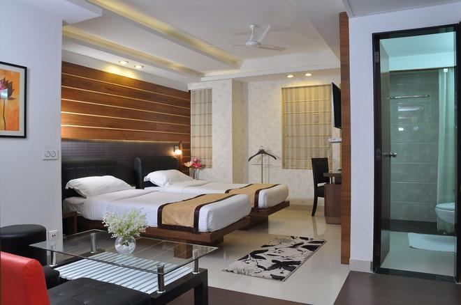 Hotel Niharika - Kolkata - Soveværelse