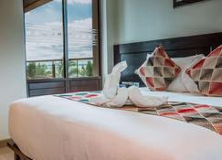 Ramada Suites by Wyndham Wailoaloa Beach Fiji - Nadi - Schlafzimmer