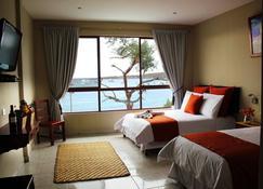 薩雅帕酒店 - 巴克里索莫雷諾港 - Puerto Baquerizo Moreno - 臥室