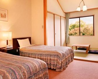 Hotel Green Plaza Karuizawa - Tsumagoi - Спальня
