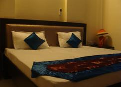 Hotel Abhinandan Grand - Dehradun - Makuuhuone